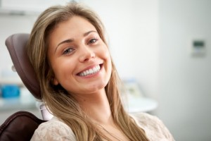 smiling-woman-in-dental-chair-300x200